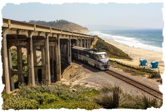 Amtrak under the Del Mar Bridge at Torrey Pines State Beach near San Diego, California