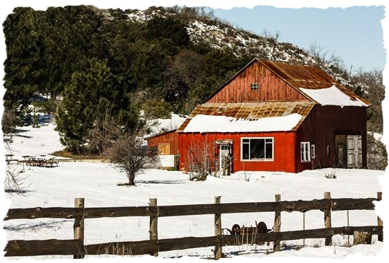Old red barn in the new snow