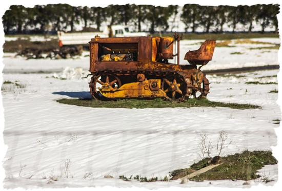 Old tractor in the new snow