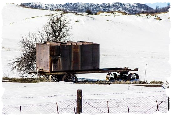 Old farming equipment in the new snow