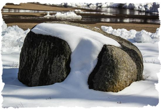 Snow-covered rock