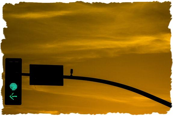 Traffic signal silhouette at sunset