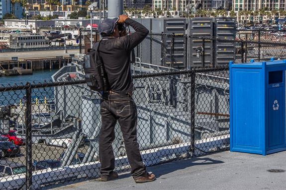 Rommel taking pictures of the San Diego skyline from the flight deck of the USS MIdway