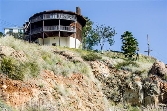 Round house on a sandstone cliff
