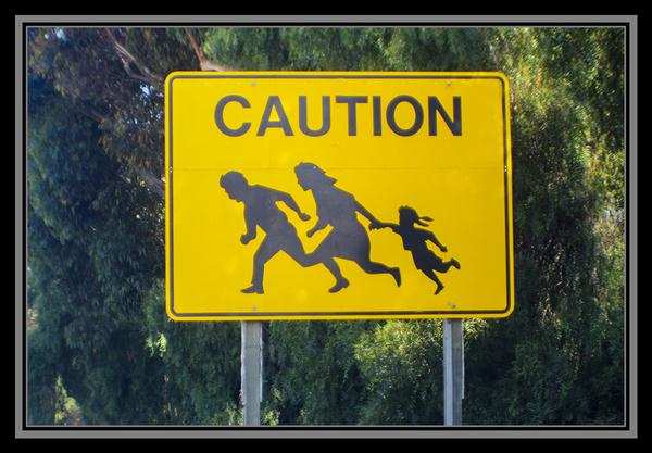 Caution: Family crossing highway