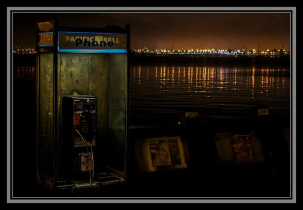 Telephone booth at night