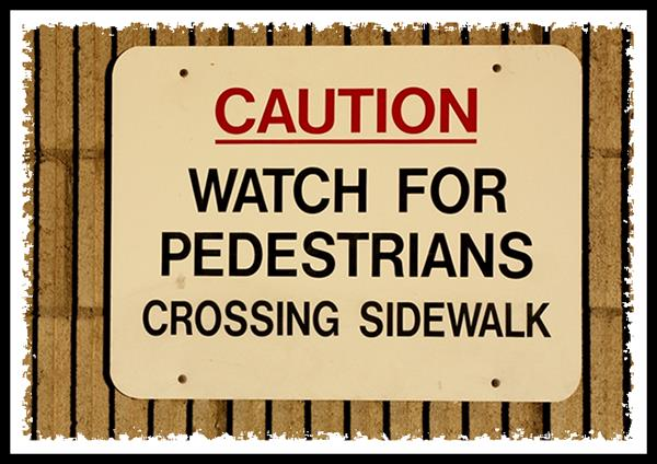 Caution, Watch for pedestrians crossing sidewalk