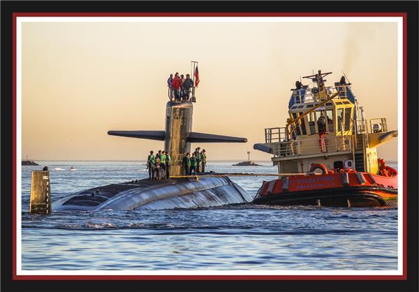 Submarine and tugboat