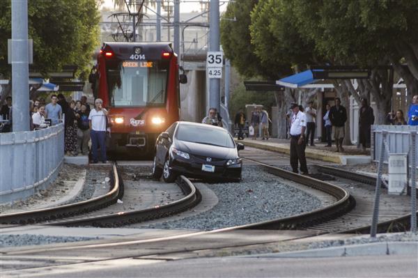 Car stuck on railroad tracks