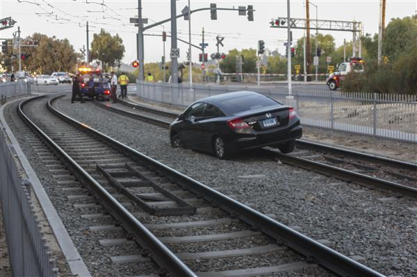 Car stuck on railroad tracks
