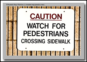 Caution: Watch for pedestrians crossing sidewalk