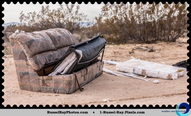 Sofa bed dumped in the desert