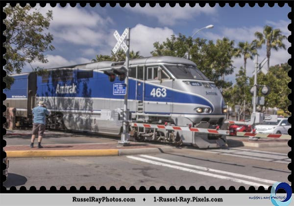 Bryan Flint taking a picture of an Amtrak train in Carlsbad CA