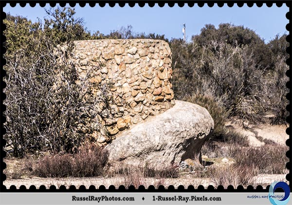 Stone tower on rounded boulder on Tierra del Sol Road, Old Highway 80, San Diego County
