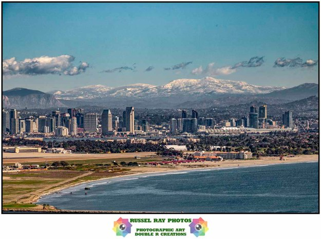 San Diego with snow-capped mountains in the background