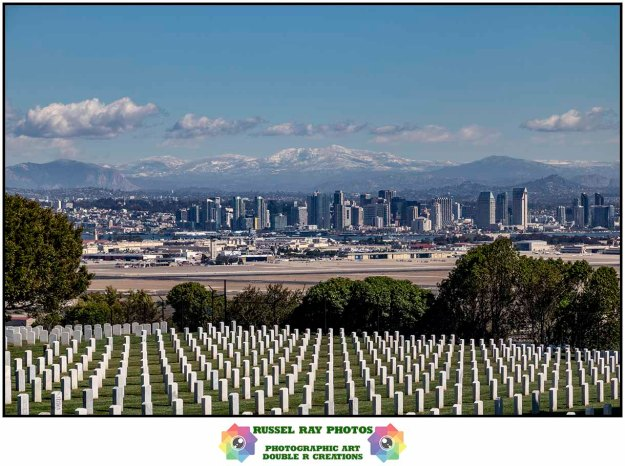 Fort Rosecrans National Cemetery, downtown San Diego, and snow-capped mountains